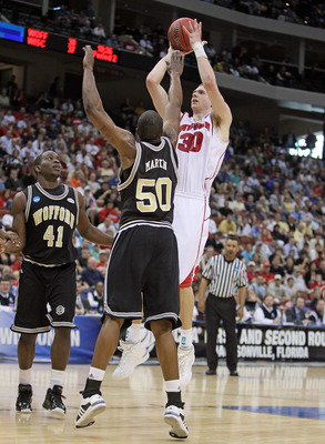 JACKSONVILLE, FL - MARCH 19:  Jon Leuer #30 of the Wisconsin Badgers shoots the ball while defended by Terry Martin #50 of the Wofford Terriers during the first round of the 2010 NCAA men's basketball tournament at Jacksonville Veteran's Memorial Arena on