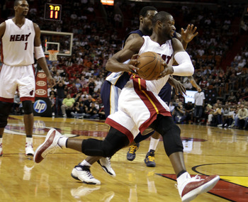 MIAMI - MARCH 12:  Guard Dwyane Wade #3 of the Miami Heat drives against the Memphis Grizzlies at American Airlines Arena on March 12, 2011 in Miami, Florida. NOTE TO USER: User expressly acknowledges and agrees that, by downloading and/or using this Phot