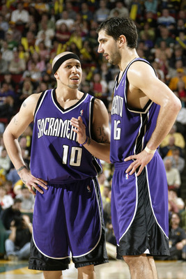SEATTLE - MAY 3:  Mike Bibby #10 of the Sacramento Kings talks to his teammate Peja Stojakovic #16 in Game five of the Western Conference Quarterfinals against the Seattle Sonics during the 2005 NBA Playoffs at Key Arena on May 3, 2005 in Seattle, Washing