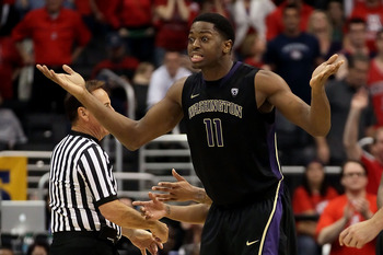 LOS ANGELES, CA - MARCH 12:  Matthew Bryan-Amaning #11 of the Washington Huskies reacts after picking up his fifth foul while taking on the Arizona Wildcats in the championship game of the 2011 Pacific Life Pac-10 Men's Basketball Tournament at Staples Ce