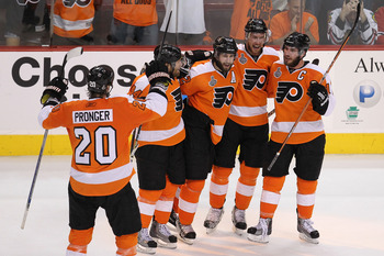 PHILADELPHIA - JUNE 04:  Jeff Carter #17 of the Philadelphia Flyers celebrates with teammates Chris Pronger #20, Kimmo Timonen #44, Simon Gagne #12 and Mike Richards #18 after scoring an empty-net goal in the third period against the Chicago Blackhawks to
