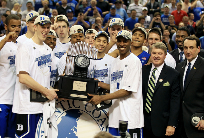 GREENSBORO, NC - MARCH 13:  The Duke Blue Devils celebrate with the ACC Championship Trophy after their 75-58 victory over the North Carolina Tar Heels in the championship game of the 2011 ACC men's basketball tournament at the Greensboro Coliseum on Marc