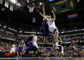 INDIANAPOLIS, IN - MARCH 11:  Jon Diebler #33 of the Ohio State Buckeyes drives for a shot attempt against John Shurna #24 of the Northwestern Wildcats during the quarterfinals of the 2011 Big Ten Men's Basketball Tournament at Conseco Fieldhouse on March
