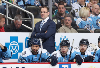 PITTSBURGH, PA - FEBRUARY 23:  Head coach Dan Bylsma of the Pittsburgh Penguins watches from the bench during the NHL game against the San Jose Sharks at Consol Energy Center on February 23, 2011 in Pittsburgh, Pennsylvania.  The Sharks defeated the Pengu