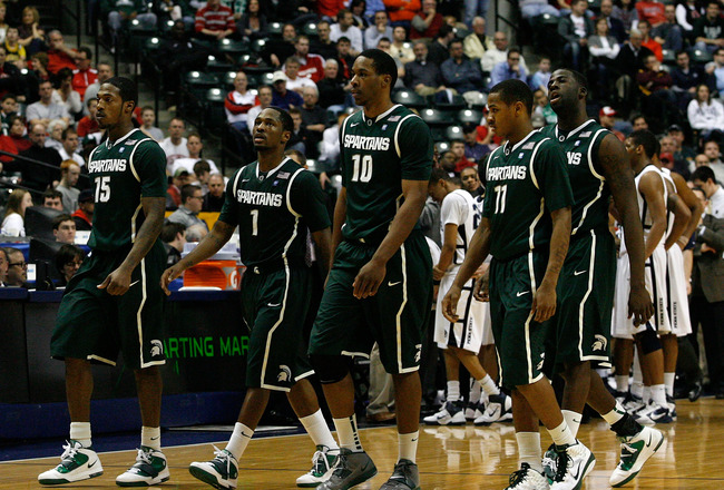 INDIANAPOLIS, IN - MARCH 12:  (L-R) Durrell Summers #15, Kalin Lucas #1, Delvon Roe #10, Keith Appling #11 and Draymond Green #23 of the Michigan State Spartans walk towards the bench during a timeout in the final minutes of ttheir 61-48 loss against the
