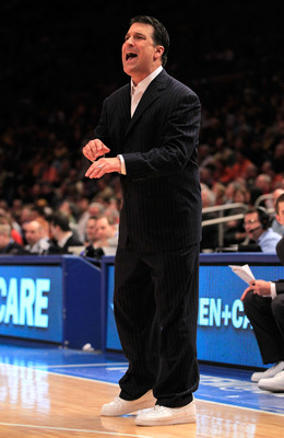 NEW YORK, NY - MARCH 10:  Head coach Steve Lavin of the St. John's Red Storm gestures from the bench during the first half against the Syracuse Orange during the quarterfinals of the 2011 Big East Men's Basketball Tournament presented by American Eagle Ou
