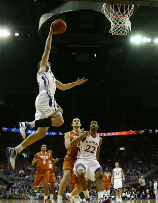 KANSAS CITY, MO - MARCH 12:  Tyrel Reed #14 of the Kansas Jayhawks dunks the ball against the Texas Longhorns in the first half of the 2011 Phillips 66 Big 12 Men's Basketball Tournament championship game at Sprint Center on March 12, 2011 in Kansas City,