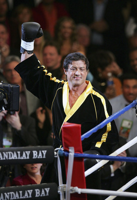 LAS VEGAS - DECEMBER 03:  Actor Sylvester Stallone waves to the crowd as scenes from the film 'Rocky VI' are filmed before the start of the Bernard Hopkins and Jermain Taylor fight at the Mandalay Bay Events Center on December 3, 2005 in Las Vegas, Nevada