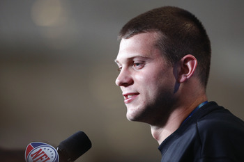 INDIANAPOLIS, IN - FEBRUARY 25: Washington Huskies quarterback Jake Locker answers questions during a media session at the 2011 NFL Scouting Combine at Lucas Oil Stadium on February 25, 2011 in Indianapolis, Indiana. (Photo by Joe Robbins/Getty Images)