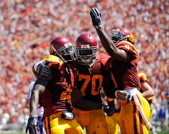 LOS ANGELES, CA - SEPTEMBER 05:  Joe McKnight #4 of the USC Trojans celebrates his touchdown with Tyron Smith #70 and David Ausberry #9 during the second quarter against the San Jose State Spartans at Los Angeles Memorial Coliseum on September 5, 2009 in