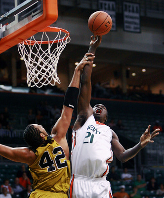 MIAMI - NOVEMBER 28:  Jamarr Sanders #21 of the Miami Hurricanes is fouled by Chief Kickingstallionsims #42 of the Alabama State Hornets at BankUnited Center on November 28,  2007 in Miami, Florida.  (Photo by Doug Benc/Getty Images)