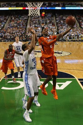 GREENSBORO, NC - MARCH 12:  Demontez Stitt #2 of the Clemson Tigers shoots against John Henson #31 of the North Carolina Tar Heels in the semifinals of the 2011 ACC men's basketball tournament at the Greensboro Coliseum on March 12, 2011 in Greensboro, No