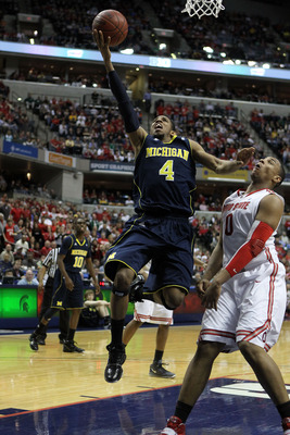 INDIANAPOLIS, IN - MARCH 12:  Darius Morris #4 of the Michigan Wolverines attempts a shot against Jared Sullinger #0 of the Ohio State Buckeyes during the semifinals of the 2011 Big Ten Men's Basketball Tournament at Conseco Fieldhouse on March 12, 2011 i