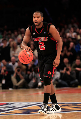 NEW YORK, NY - MARCH 11: Preston Knowles #2 of the Louisville Cardinals brings the ball up court against the Notre Dame Fighting Irish during the semifinals of the 2011 Big East Men's Basketball Tournament presented by American Eagle Outfitters at Madison
