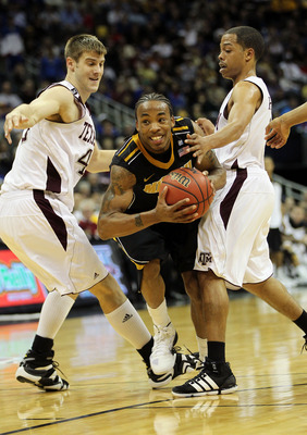 KANSAS CITY, MO - MARCH 10:  Marcus Denmon #12 of the Missouri Tigers drives to the hoop against the Texas A&M Aggies during their quarterfinal game in the 2011 Phillips 66 Big 12 Men's Basketball Tournament at Sprint Center on March 10, 2011 in Kansas Ci
