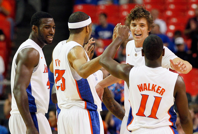 ATLANTA, GA - MARCH 12:  The Florida Gators celebrate after defeating the Vanderbilt Commodores 77 to 66 during the semifinals of the SEC Men's Basketball Tournament at Georgia Dome on March 12, 2011 in Atlanta, Georgia.  (Photo by Kevin C. Cox/Getty Imag