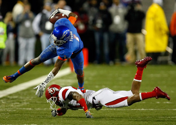 LAS VEGAS, NV - DECEMBER 22:  Titus Young #1 of the Boise State Broncos is tripped up by Brian Blechen #2 of the Utah Utes during the MAACO Bowl Las Vegas at Sam Boyd Stadium December 22, 2010 in Las Vegas, Nevada.  (Photo by Ethan Miller/Getty Images)
