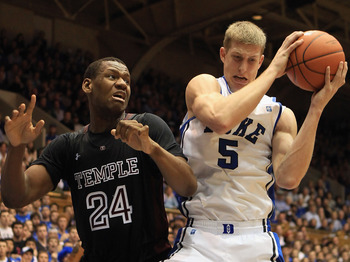 DURHAM, NC - FEBRUARY 23: Lavoy Allen #24 of the Temple Owls battles for a loose ball with Mason Plumlee #5 of the Duke Blue Devils during their game at Cameron Indoor Stadium on February 23, 2011 in Durham, North Carolina.  (Photo by Streeter Lecka/Getty