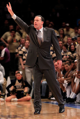 NEW YORK, NY - MARCH 10:  head coach Jamie Dixon of the Pittsburgh Panthers gestures from the bench against the Connecticut Huskies during the quarterfinals of the 2011 Big East Men's Basketball Tournament presented by American Eagle Outfitters  at Madiso
