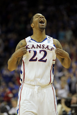 KANSAS CITY, MO - MARCH 12:  Marcus Morris #22 of the Kansas Jayhawks celebrates after a play against the Texas Longhorns during the 2011 Phillips 66 Big 12 Men's Basketball Tournament championship game at Sprint Center on March 12, 2011 in Kansas City, M