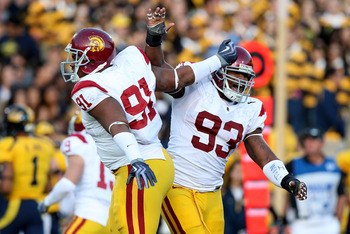 BERKELEY, CA - OCTOBER 3: Everson Griffen #93 of the USC Trojans celebratres with teammate Jurrell Casey #91 after a sack against the California Golden Bears at Memorial Stadium on October 3, 2009 in Berkeley, California.  (Photo by Jed Jacobsohn/Getty Im