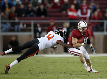 PALO ALTO, CA - NOVEMBER 27:   Ryan Whalen #8 of the Stanford Cardinal avoid being tackled by a diving James Dockery #4 of the Oregon State Beavers at Stanford Stadium on November 27, 2010 in Palo Alto, California.  (Photo by Ezra Shaw/Getty Images)