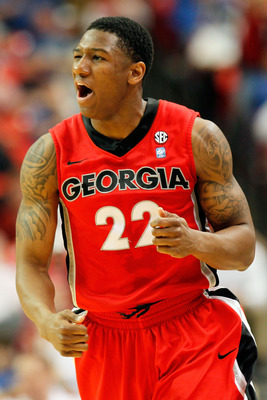 ATLANTA, GA - MARCH 11:  Gerald Robinson #22 of the Georgia Bulldogs celebrates after hitting a 3 point shot against the Alabama Crimson Tide during the quarterfinals of the SEC Men's Basketball Tournament at Georgia Dome on March 11, 2011 in Atlanta, Geo