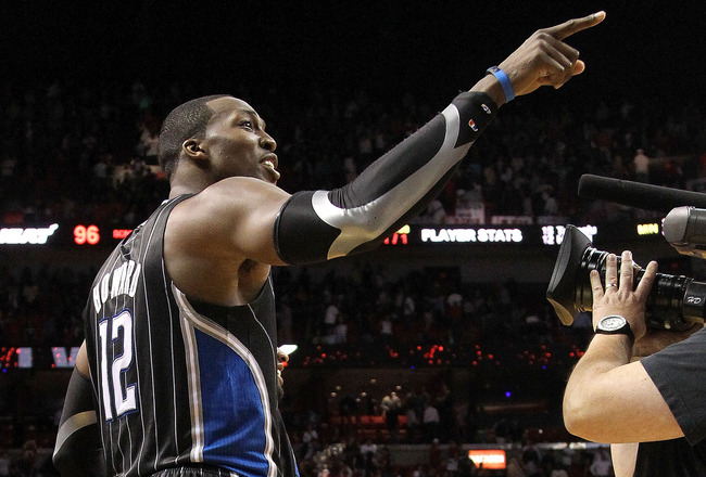 MIAMI, FL - MARCH 03:  Dwight Howard #12 of the Orlando Magic points to a heckler after winning a game against the Miami Heat at American Airlines Arena on March 3, 2011 in Miami, Florida. NOTE TO USER: User expressly acknowledges and agrees that, by down