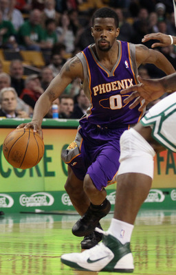 BOSTON, MA - MARCH 02:  Aaron Brooks #0 of the Phoenix Suns heads for the net in the second half against the Boston Celtics on March 2, 2011 at the TD Garden in Boston, Massachusetts.  The Celtics defeated the Suns 115-103. NOTE TO USER: User expressly ac
