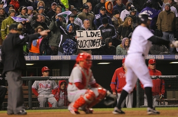 DENVER - OCTOBER 11:  Fans of the Colorado Rockies cheer for their team and hold up a sign which reads 'I Love Rocktober' against the Philadelphia Phillies in Game Three of the NLDS during the 2009 MLB Playoffs at Coors Field on October 11, 2009 in Denver