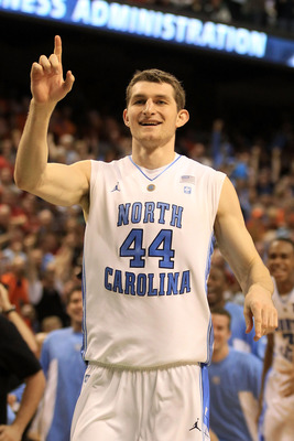 GREENSBORO, NC - MARCH 11:  Tyler Zeller #44 of the North Carolina Tar Heels celebrates after defeating the Miami Hurricanes 61-59 during the second half in the quarterfinals of the 2011 ACC men's basketball tournament at the Greensboro Coliseum on March