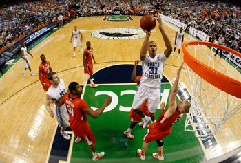 GREENSBORO, NC - MARCH 12:  John Henson #31 of the North Carolina Tar Heels shoots against Tanner Smith #5 of the Clemson Tigers in the semifinals of the 2011 ACC men's basketball tournament at the Greensboro Coliseum on March 12, 2011 in Greensboro, Nort