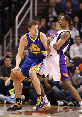 PHOENIX, AZ - FEBRUARY 10:  David Lee #10 of the Golden State Warriors handles the ball during the NBA game against the Phoenix Suns at US Airways Center on February 10, 2011 in Phoenix, Arizona.  The Suns defeated the Warriors 112-88.  NOTE TO USER: User