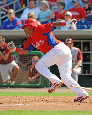 CLEARWATER, FL - FEBRUARY 24:  Infielder Michael Martinez #19  of the Philadelphia Phillies bats against the Florida State Seminoles February 24, 2011 at Bright House Field in Clearwater, Florida.  (Photo by Al Messerschmidt/Getty Images)