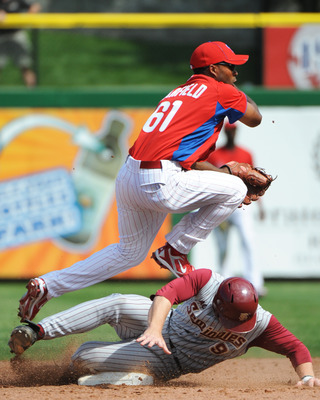 CLEARWATER, FL - FEBRUARY 24:  Infielder Josh Barfield #61 of the Philadelphia Phillies throws to first base against the Florida State Seminoles February 24, 2011 at Bright House Field in Clearwater, Florida.  (Photo by Al Messerschmidt/Getty Images)