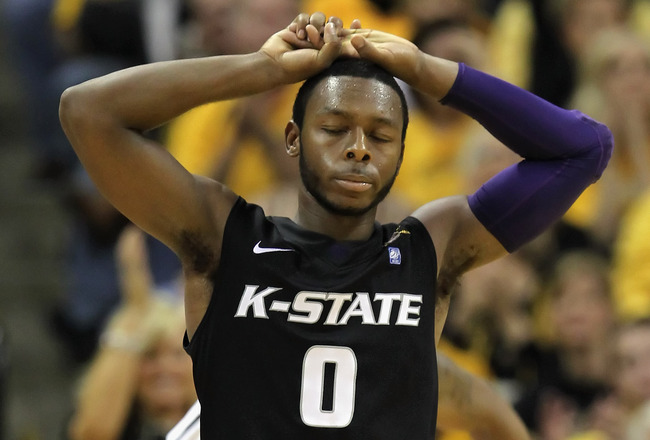 COLUMBIA, MO - JANUARY 17:  Jacob Pullen #0 of the Kansas State Wildcats reacts after committing a foul during the game against the Missouri Tigers on January 17, 2011 at Mizzou Arena in Columbia, Missouri.  (Photo by Jamie Squire/Getty Images)