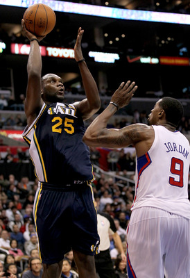 LOS ANGELES, CA - DECEMBER 29:  Al Jefferson #25 of the Utah Jazz shoots over DeAndre Jordan #9 of the Los Angeles Clippers at Staples Center on December 29, 2010 in Los Angeles, California.   The Jazz won 103-85.  NOTE TO USER: User expressly acknowledge
