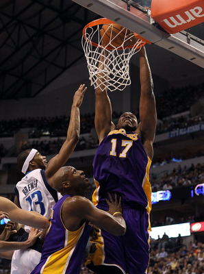DALLAS, TX - MARCH 12:  Center Andrew Bynum #17 of the Los Angeles Lakers gets the slam dunk against Corey Brewer #13 of the Dallas Mavericks at American Airlines Center on March 12, 2011 in Dallas, Texas.  NOTE TO USER: User expressly acknowledges and ag