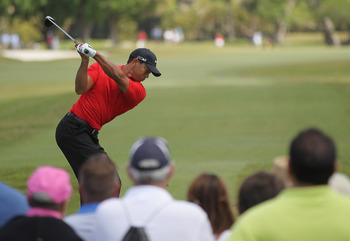 DORAL, FL - MARCH 13:  Tiger Woods hits his tee shot on the third hole during the final round of the 2011 WGC- Cadillac Championship at the TPC Blue Monster at the Doral Golf Resort and Spa on March 13, 2011 in Doral, Florida.  (Photo by Mike Ehrmann/Gett