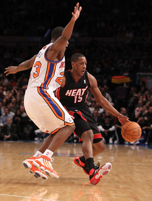 NEW YORK - DECEMBER 17:  Mario Chalmers #15 of the Miami Heat in dribbles against Toney Douglas #23 of the New York Knicks at Madison Square Garden on December 17, 2010 in New York, New York.  (Photo by Al Bello/Getty Images)