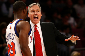 NEW YORK - NOVEMBER 06:  Head coach Mike D'Antoni of the New York Knicks talks with Toney Douglas #23 during a time out against the Cleveland Cavaliers at Madison Square Garden November 6, 2009 in New York City. NOTE TO USER: User expressly acknowledges a