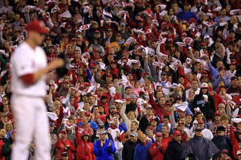 PHILADELPHIA - OCTOBER 06:  Fans cheer on pitcher Roy Halladay #34 of the Philadelphia Phillies as he prepares to pitch during his no-hitter in Game 1 of the NLDS against the Cincinnati Reds at Citizens Bank Park on October 6, 2010 in Philadelphia, Pennsy