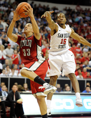LAS VEGAS, NV - MARCH 11:  Tre'Von Willis #33 of the UNLV Rebels drives to the basket in front of Kawhi Leonard #15 of the San Diego State Aztecs during a semifinal game of the Conoco Mountain West Conference Basketball tournament at the Thomas & Mack Cen