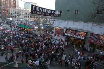 BOSTON - APRIL 04: Fans enter Yawkey Way before a game between the Boston Red Sox and the New York Yankees on Opening Night at Fenway Park on April 4, 2010 in Boston, Massachusetts. (Photo by Jim Rogash/Getty Images)