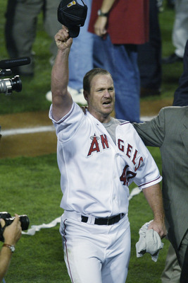 ANAHEIM, CA - OCTOBER 27:  Troy Percival #40 of the Anaheim Angels salutes the crowd after the victory over the San Francisco Giants as he is led to an interview after game seven of the World Series on October 27, 2002 at Edison Field in Anaheim, Californ
