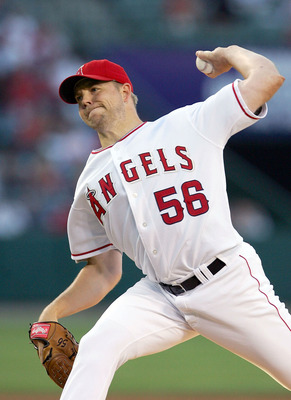 ANAHEIM, CA - JUNE 22:  Jarrod Washburn #56 of the Los Angeles Angels of Anaheim pitches against the Texas Rangers on June 22, 2005 at Angel Stadium in Anaheim, California.  (Photo by Lisa Blumenfeld/Getty Images)
