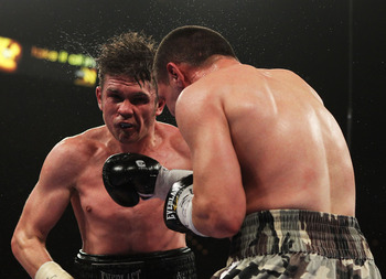 LAS VEGAS - MARCH 12:  Pawel Wolak punches Yuri Foreman during their Super Welterweight bout at the MGM Grand Garden Arena on March 12, 2011 in Las Vegas, Nevada.  (Photo by Al Bello/Getty Images)