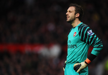 MANCHESTER, ENGLAND - MARCH 12:  Manuel Almunia of Arsenal looks dejected after conceding the opening goal during the FA Cup sponsored by E.On Sixth Round match between Manchester United and Arsenal at Old Trafford on March 12, 2011 in Manchester, England