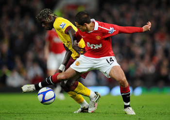 MANCHESTER, ENGLAND - MARCH 12:  Bacary Sagna of Arsenal and Javier Hernandez of Manchester United battle for the ball during the FA Cup sponsored by E.On Sixth Round match between Manchester United and Arsenal at Old Trafford on March 12, 2011 in Manches