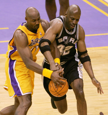 LOS ANGELES - MAY 15:  Karl Malone #11 of the Los Angeles Lakers and Kevin Willis #42 of the San Antonio Spurs during Game six of the Western Conference Semifinals during the 2004 NBA Playoffs at Staples Center on May 15, 2004 in Los Angeles, California.